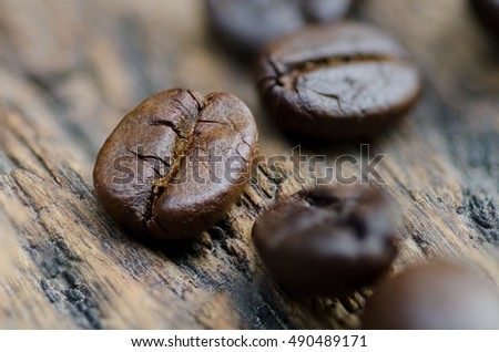 Close up coffee bean roasted on wood background