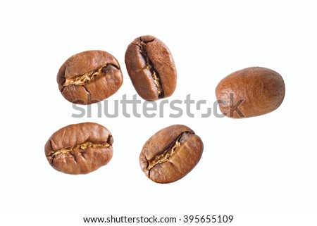 Close up coffee beans on a white background. Isolated coffee beans on a white background. Coffee beans of high resolution. Close up coffee beans photographed. - stock photo