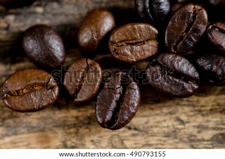 Close up coffee beans roasted on wood background