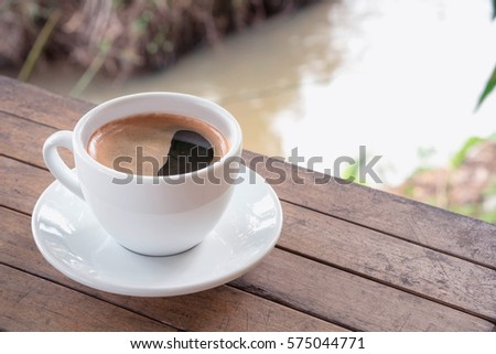 Close up Coffee cup on woodden table