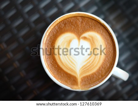 Close up Coffee latte art on black background - stock photo