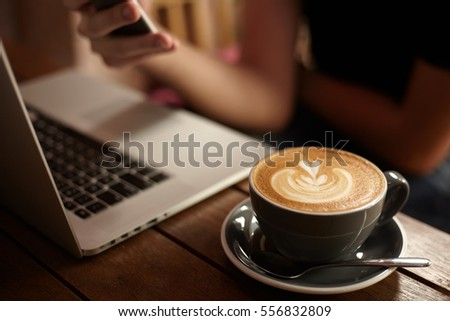 Close up coffee lifestyle with laptop on the wooden table in cafe