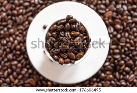 Close-up coffee mug, with coffee beans in it