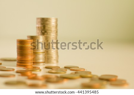 Close up coin stacked growing. For business growth and financial concept,vintage color,selective focus.