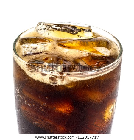 close up cola with ice on the grass - stock photo