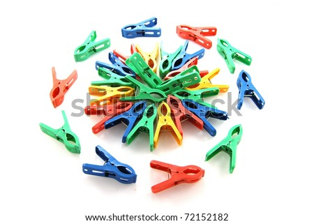 Close up color clothespins on white background