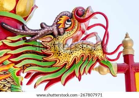 Close up colorful head dragon statue. The statue of a Chinese dragon is the power. - stock photo