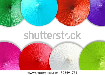 Close up colorful of umbrellas on white background. - stock photo