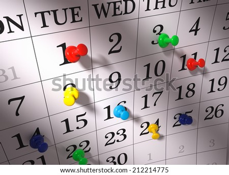 Close up , colorful pushpins on calendar - stock photo