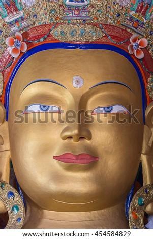 Close up colorful sculpture of Maitreya buddha at Thiksey Monastery, Tibetan Buddhist monastery in Ladakh, India - stock photo