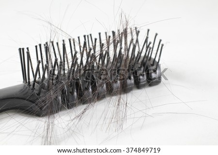 Close-up, Comb after use isolate, Women With Hair Loss Problems, There are many hair attached to a comb after use on white background - stock photo