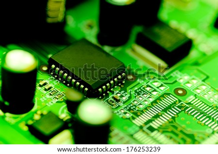 Close up computer chip on circuit - stock photo