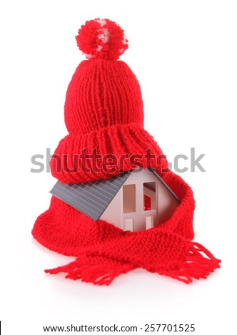 Close up Conceptual Miniature Model House with Red Wool Scarf Hat, Isolated on White Background. - stock photo