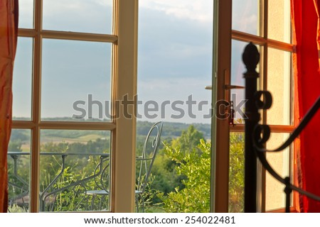 Close up Conceptual Open Glass House Windows at the Terrace with Extensive View of the Outside. - stock photo