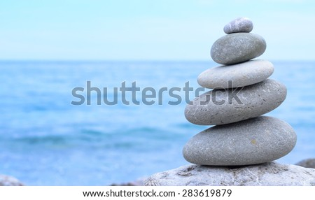 Close up Conceptual Piled Stones with Different Sizes at the Beach, Emphasizing Perfect Balance - stock photo