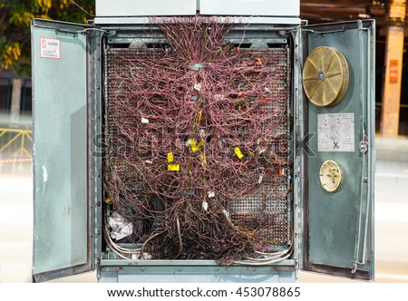 Close up confused or disordered old and dirty cable in private automatic branch exchange cabinet, problem concept, pabx - stock photo