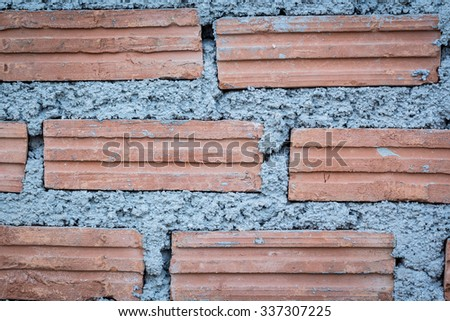 Close up construction  of red brick wall - stock photo