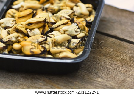 close up cooked mussels on plate - stock photo