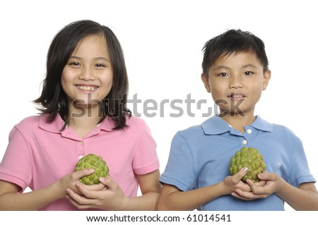Close up couple with custard apple - stock photo
