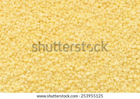 close up couscous grains background