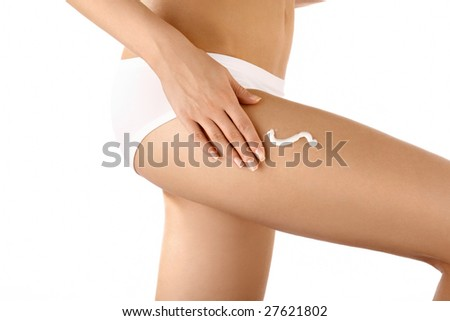 Close up cream drawing on the bared female hip, isolated - stock photo