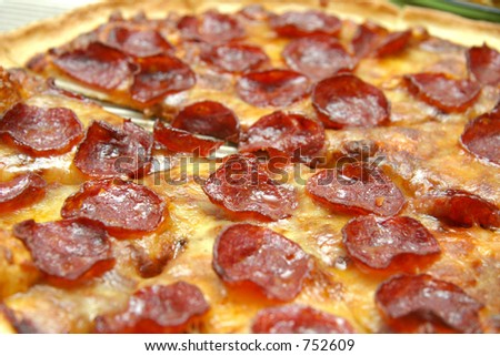 Close up crop of pepperoni pizza with cheese