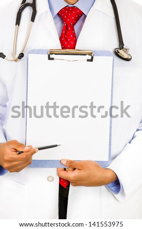 Close-up cropped image of a male doctor holding a chart  with copy space offering to sign it. - stock photo