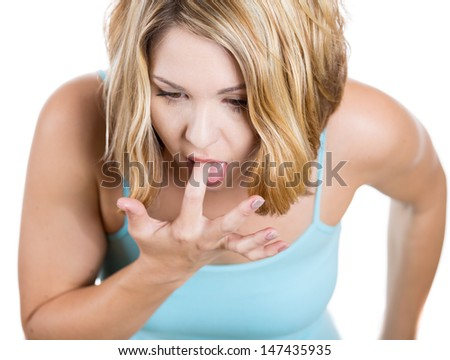 Close-up, cropped portrait of a Woman: annoyed, frustrated and fed up sticking her finger in her throat showing she is about to throw up. or a case of anorexia nervosa Isolated on a white background - stock photo