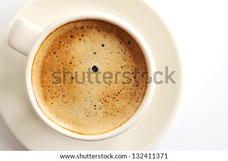 close-up cup of espresso coffee over white - stock photo