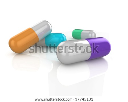 Close up 3d illustration of colored pills on a shiny surface, isolated on a white background.