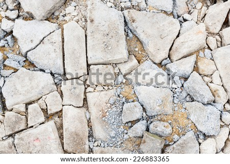 Close up damaged cracked concrete floor in construction site - stock photo