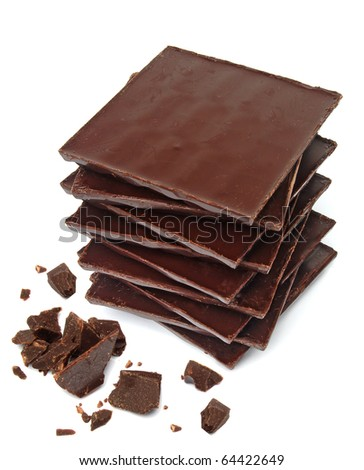 Close up dark chocolate pile with chips on white background - stock photo