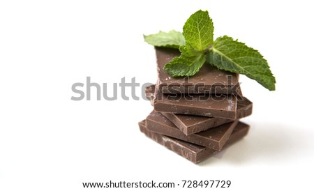 Close up Dark Chocolate Stack Fresh Mint Leaves Isolated on White Background Selective Focus Copy Space