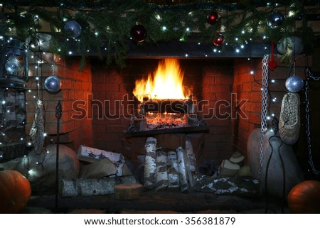 close-up decorated christmas fireplace with lights at night - stock photo