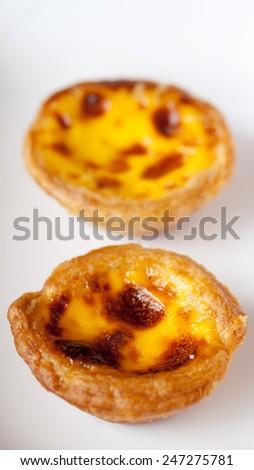 close up delicious portuguese egg tart on white box - stock photo