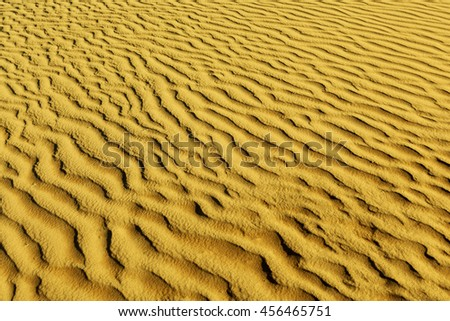 Close up desert dune background.Sands of the desert.Sand dunes at sunset in the Sahara Desert - stock photo