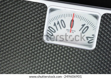 Close up detail black weight scale. - stock photo