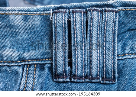 Close up detail four belt loops on blue jeans - stock photo