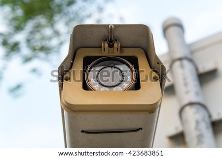 Close-up detail of a CCTV surveillance camera recording people - stock photo