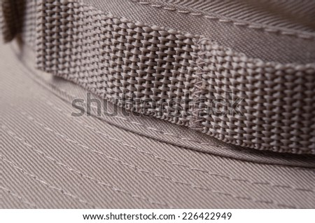 Close up detail of a khaki brown boonie hat band - stock photo