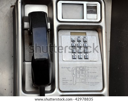 Close up Detail of a Public Pay Phone - stock photo