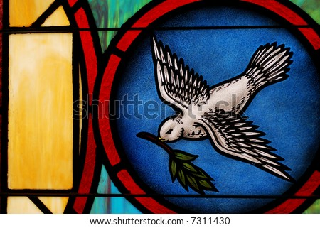 Close-up detail of a section of a church stained glass window. - stock photo