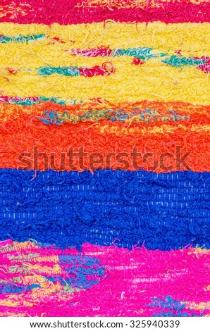 Close up detail of a typical andalusian handcrafted rug - stock photo