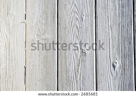 Close up detail of a white painted fence. - stock photo