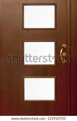 Close up  detail of an new style wooden door with three glass - stock photo