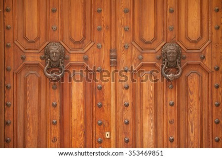 Close up detail of an ornate timber door in Barcelona, Spain. - stock photo