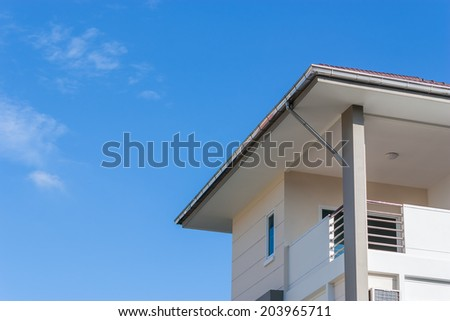 Close up detail of complex house  against blue sky.