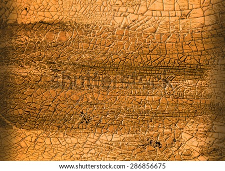 Close-up detail of cracked paint on rusty metal wall. - stock photo