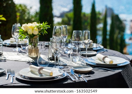 Close up detail of elegant served table outdoors. - stock photo