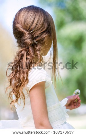 Close up detail of french twist and permanent wave hairstyle.   - stock photo